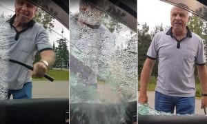 Ηλικιωμένος σπάει το τζάμι αυτοκινήτου και προσπαθεί να τραυματίσει τον οδηγό (vid)